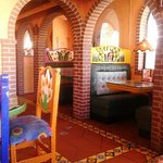 These arched entries to the booths add so much charm and coziness!