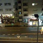 Night street scenery from my room (4th or 5th floor). At the most left is a 24h convenience stor
