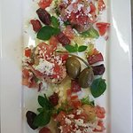 Dakos, if you prefer) Cured ham, tomato, feta cheese, caperberry and barley crouton salad with r