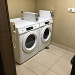 Public washer & dryer across from gym and pool