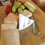 generous cheese platter with blue vein, camembert, nuts, fruit and crackers