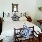 "A double bed room with charming detail. Karoo Lavender ""Rooibos Range"" products provided."