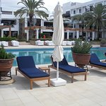 Poolside with sunbeds all with mattresses