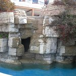 Lower pool area with cave and waterfall feature
