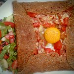 """Galette """"Saint-Malo"""": pork pepperoni, egg, tomatoes, cheese and special home-made """"maître d'hôte"""
