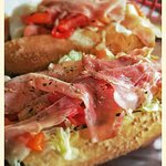 Try our Bruno. Fresh Mozzarella, Roasted Peppers, and Prosciutto.