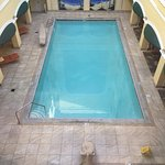 Pool area is outdoors but within the confines of the hotel.