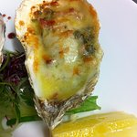 Grilled local oysters with blue cheese and bacon