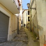 narrow street leading to center of town.