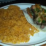 One carne asada taco (makes) two & side of rice...Yummy!!