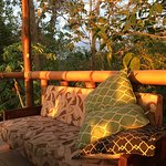 A beautiful place to watch sunset. The restaurant has space that is open to the setting sun. Amb