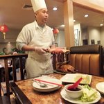 Chef and owner of Red Chopstick filleting the Beijing duck