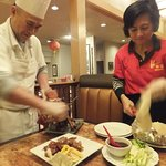 Owner/Chef and his wife preparing our Beijing Duck right infront of us at the table