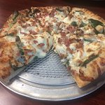 Small, chicken bacon spinach pizza with white sauce. Custom made.