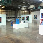 Main gallery, with fire engine doors in back, during unknown Tucson artist Robert Barber exhibit