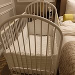 Baby crib provided by the hotel.