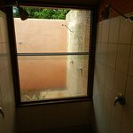 looking from the indoor shower recess outside to the outdoor shower