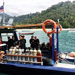 Happy divers aboard the DiveAsia Boat