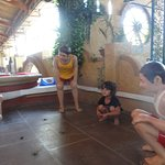 Kid njoying with the Statues set there in Dhaba