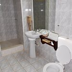 La salle de bain en chambre deluxe