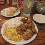Fried chicken livers with mashed potatoes and macaroni and cheese
