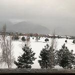 view of golf course in the snow