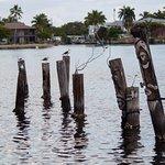 Tiki-painted pilings behind Sandy Hook Restaurant
