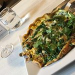 Spinach and mushroom frittata with potatoes, garlic, onions, Swiss, and basil