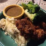 Fried Chicken plate with mushroom sauce on the side