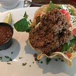 Taco Salad - beef with cheese and tomatos on a bed of greens. Sour Cream is optional