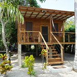 Forecastle Cabana host a full kitchen,Queen bed,table & chairs inside and on the large veranda.