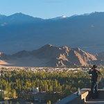 My friend taking photo on Shanti Stupa.