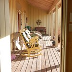 Looking out the front door of the Tumbleweed room to the front porch of the B and B,