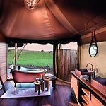 Luxury Family Tent en-suite bathroom with freestanding copper bathtub and glass enclosed shower