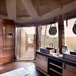 Luxury Tent en-suite bathroom with indoor shower and his & hers wash basins