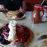 red,white and blue pancakes, and in the back, regular pancakes with 3 of 5 syrup choices
