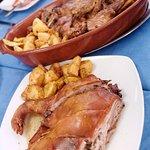 large portions Cuchinillo y Cabrita