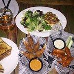 Food: Garlic Bread, Stuffed Claws, Buffalo Chicken Wings, Grilled Mahi Mahi with Salad
