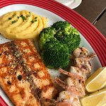 grilled salmon with shrimp served with mushroom Alfredo sauce