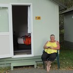 Mum sitting outside our basic twin cabin