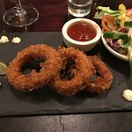 fried calamari served on a slate tile