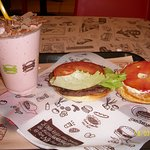 burger with nice tomatoes and strawberry shake