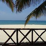 Veranda and beach at Travellers Cafe