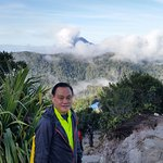 Mount Sinabung in the background.