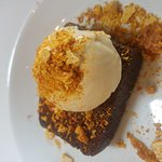Warm ginger cake with salted caramel ice cream and honeycomb crumb
