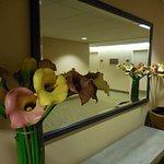 Pleasant hallway decoration featuring calla-lilies