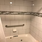 Jetted tub, nice tile work (with clean grout), shower head extension for us tall guys.