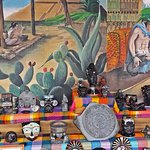 Mural and products for sale at El Quetzel