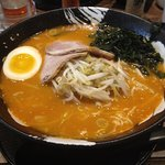 Spicy ramen with cha su, seaweed, soft boiled egg