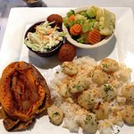 Grilled scallops with steamed veggies and baked sweet potato